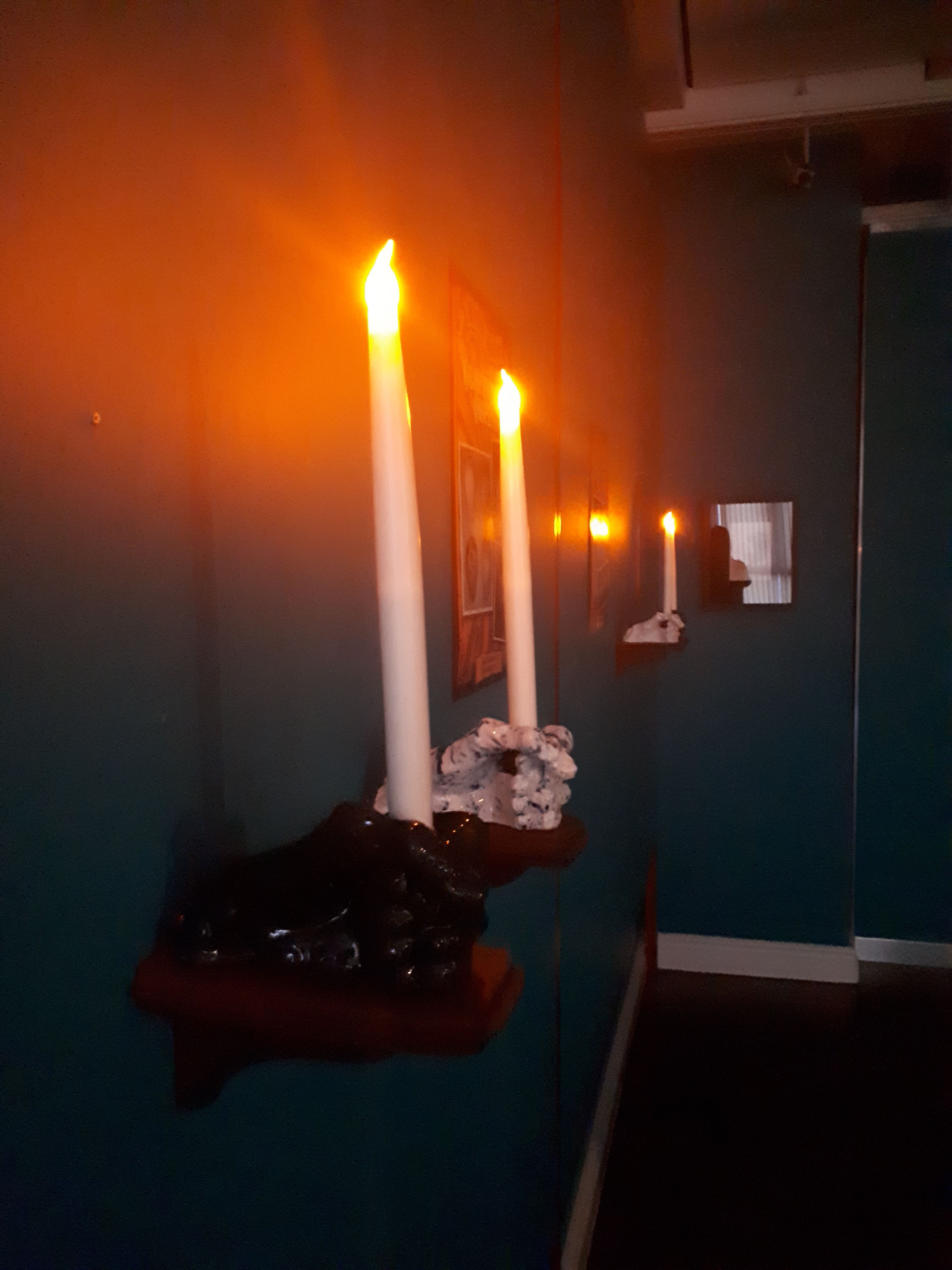 Lit Candles on Wall 2